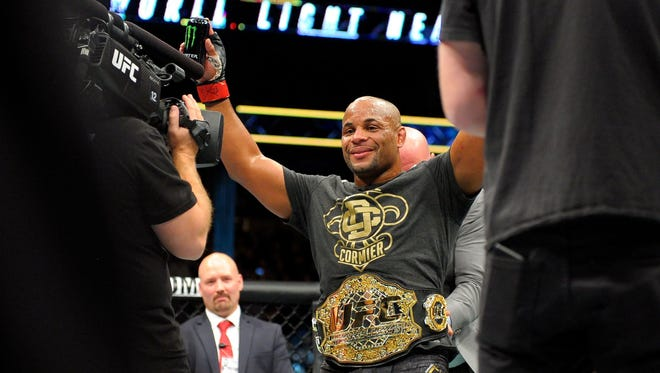 Northside High School graduate Daniel Cormier made UFC history this year as the holder of two titles.
