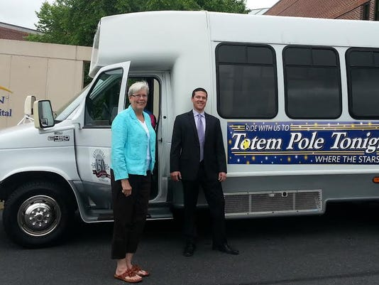 Dana Witt, left, president of the board of directors of Totem Pole Playhouse, and Max Felty, president of Gettysburg Tours, alongside a Gettysburg Hospital volunteer with the new Totem Pole Trolley which will take patrons from Gettysburg to the playhouse free-of-charge weeknights throughout the summer sponsored by WellSpan Gettysburg Hospital.