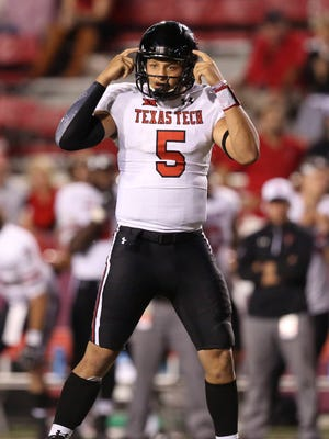 Texas Tech quarterback Patrick Mahomes II (5) signals prior to a snap in a win against Arkansas on Sept. 19.