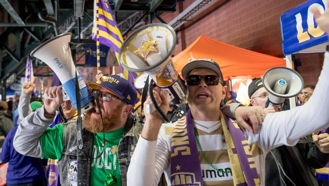 Louisville City fans enter the stadium, singing fight songs, before a game against Nashville FC at Louisville Slugger Field on Saturday, March 17, 2018.