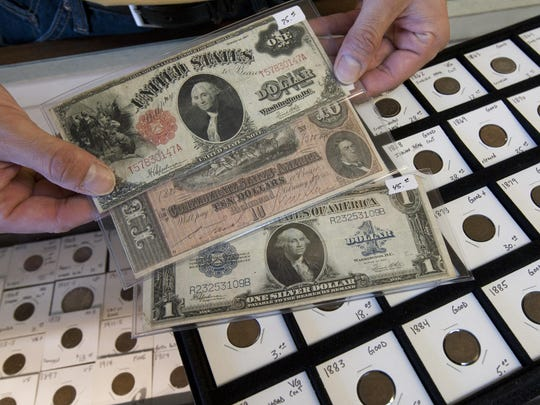 Some of the collectible coins and paper money for sale in a booth owned by Tom Surina, Old Bridge, at Honey Hole Antiques in Keyport.