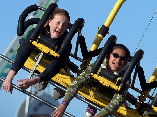 Megan Laack, left, and Isabel Salas take a twirl on the Cliff Hanger at a past Conejo Valley Days carnival. The 2018 event runs May 10-13 in Thousand Oaks.