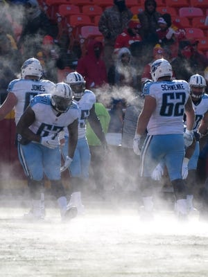 The Tennessee Titans warm up on a frozen field before an NFL football game against the Kansas City Chiefs in Kansas City, Mo., Sunday, Dec. 18, 2016. (AP Photo/Ed Zurga)