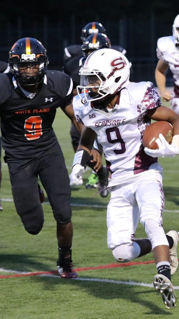 Scarsdale's Ajani Bowie is chased by White Plains'