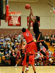 IU commit Freddie McSwain skies over an opponent for a dunk.