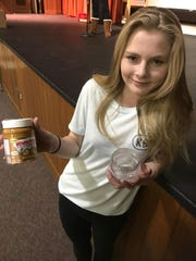 """Lindsay Crawford's """"double jar"""" that featured a peanut butter jar that opens on both ends to avoid having to scrape deep to the bottom of the jar was judged the winner of a """"Shark Tank"""" event on Jan. 6 at Shattuck Middle School in Neenah."""