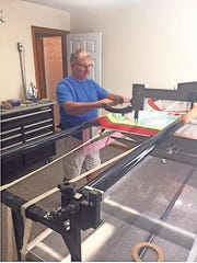Dan Markey with his long-arm quilting machine.