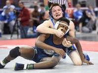 Viking wrestler Ethan Herb, wrestling 160, defeated Bishop McDevitt's Justin Piper during the PIAA Semi-final rounds at the Giant Center in Hershey, Friday night, Feb. 10. Northern Lebanon wrestled to a win against Bishop McDevitt to advance to the state finals.