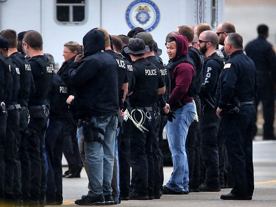 Memphis Police line up before arresting protesters with the organization Arkansas Rising during a demonstration in front of the Valero refinery in south Memphis to protest the construction of the Diamond Pipeline. Twelve were arrested after at least seven people chained themselves to large, concrete-filled barrels.