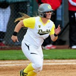 Oregon's Hailey Decker watches a home run off her bat against Washington at Howe Field, on Sunday, March 29, 2015, in Eugene. Oregon won the game 15-6 in 5 innings.