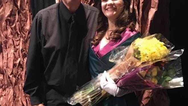Thomas More Prep-Marian vocal music teacher Jim Balthazor, with TMP student Anne Wasinger after a performance her freshman year.