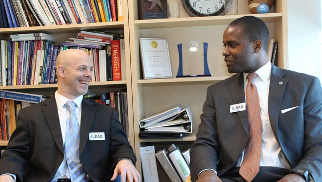 Principal Stanley Spoor, of Howard High School of Technology, is pictured with Eugene Young.