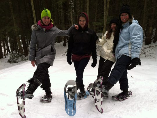 Rachel, Laura, Julie, and Cindy Prestigiacomo pose on snowshoes during a tour of the Ben & Jerry's factory in Waterbury, Vt.