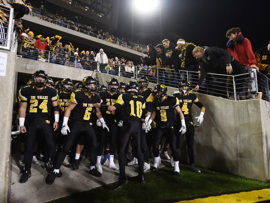 Tri-Valley takes the field against Trotwood Madison in the Division III state final this past season. The Scotties have won seven straight MVL football titles.
