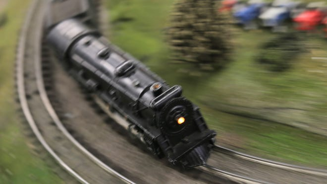 Model trains run on a display during Mohican Winter Fest in downtown Loudonville on Saturday.
