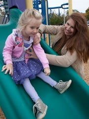 Parents of elementary school students have signed a petition that opposes a Middletown school district policy that reduces recess from 20 minutes to 15 minutes. Katie Doyle, the leader of the group, with her daughter Anna, 5 -October 27, 2015-Middletown, NJ.-Staff photographer/Bob Bielk/Asbury Park Press