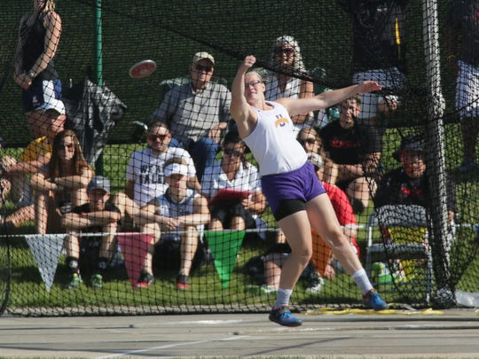 Unioto's Autumn Mohan throws the discus during the Division II state track meet at Jesse Owens Memorial Stadium Friday.