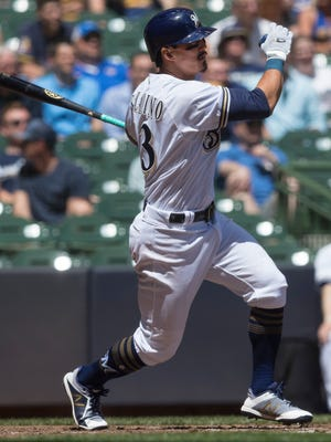 Brewers second baseman Tyler Saladino looks on as he hits a two-run double Wednesday.