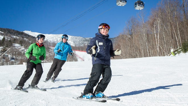 This Jan. 14, 2015 photo provided by ORDA/Whiteface Lake Placid, shows Megan Gardner, right, as she teaches participants in a lesson at Whiteface Mountain in Wilmington, N.Y., near Lake Placid. Whiteface, like other ski resorts, is creating programs to attract younger skiers as a way of maintaining interest in the sport as baby boomers age out.