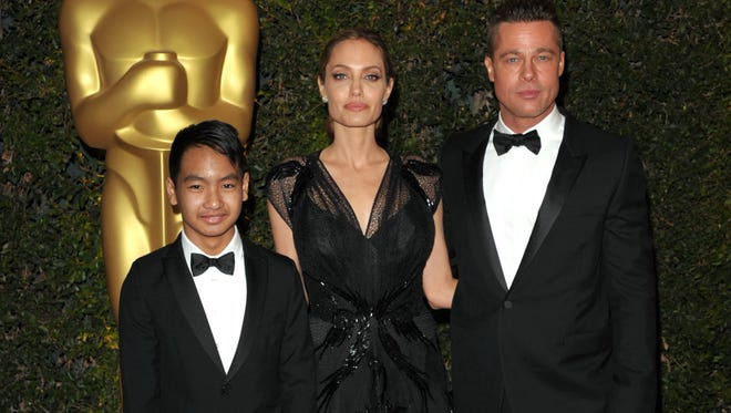 Angelina Jolie, Brad Pitt and son Maddox, in happier days, in November 2013 in Los Angeles.