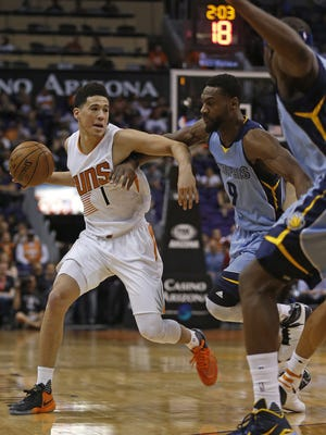 Suns' Devin Booker (1) drives to the hoop against Grizzlies' Tony Allen (9) in the first half at Talking Stick Resort Arena in Phoenix, Ariz. on Monday, March 21, 2016.