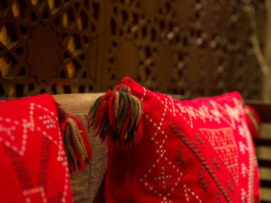 Red Pillow on sofa,  interior morocco style