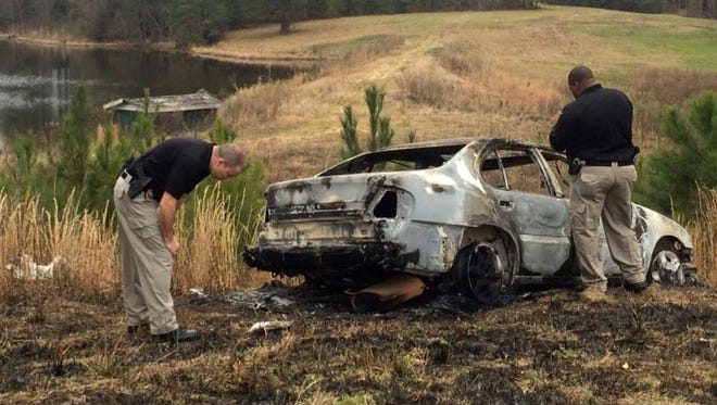 Southern Miss campus police investigate abandoned, burned vehicle on the university's property.