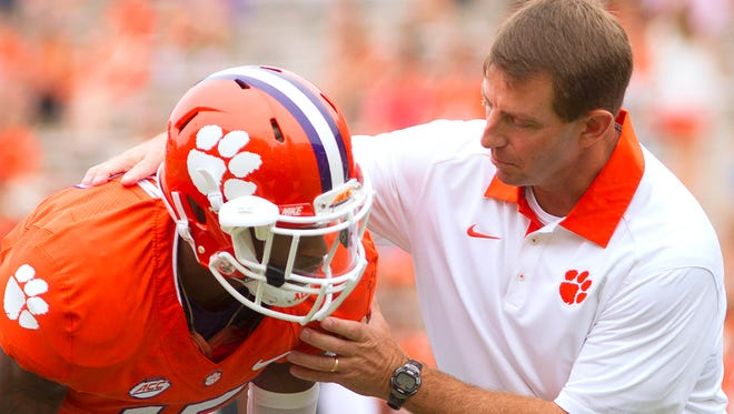 Clemson Tigers head coach Dabo Swinney speaks with safety T.J. Green (15) prior to the game against the Appalachian State Mountaineers at Clemson Memorial Stadium.