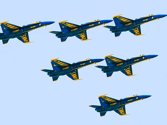 Pilots with the U.S. Navy Flight Demonstration Squadron, the Blue Angels, fly over Nashville, on Thursday, June 12, for a scheduled team photo shoot.