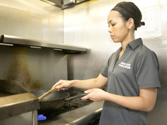 Owner Yia Xiong prepares kampong at Lemon Grass Noodle House in Stevens Point.