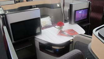 Qatar Airways' new 'Qsuite' business class seats are seen on one of the airline's Boeing 777 jets at the Paris Air show on June 19, 2017.