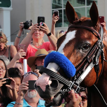 Fans turn out at Churchill Downs Saturday night to