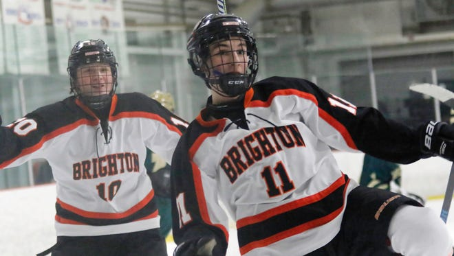 Brighton's Noah Stanko celebrates the first of his three goals in a 9-1 victory over Howell on Friday, Jan. 26, 2018.