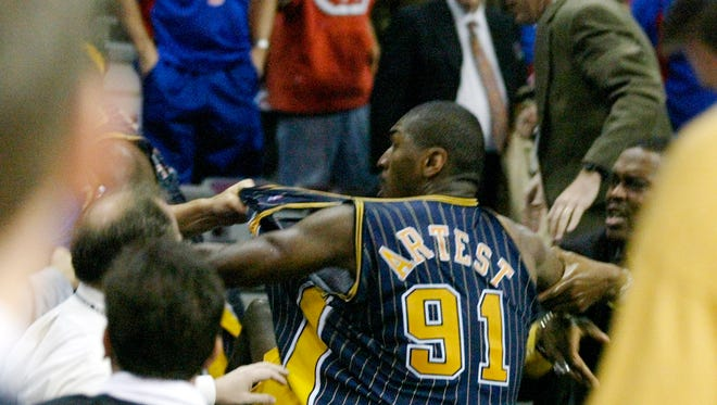 Indiana Pacers forward Ron Artest is grabbed by fans after he went into the seats during a a brawl with the Detroit Pistons with just 45.9 seconds left in the game Friday, Nov. 19, 2004, in Auburn Hills, Mich. The game was called by the officials.  (AP Photo/Duane Burleson)