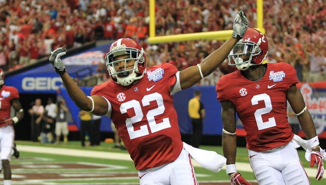 Alabama wide receiver Christion Jones (22) celebrates his punt return for a touchdown against Virginia Tech in the first quarter of the 2013 Chick-Fil-A Kickoff game at the Georgia Dome.