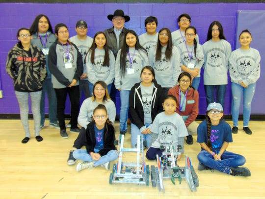 "Mescalero Apache President Arthur ""Butch"" Blazer stands with members of the Mescalero STEM team."