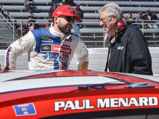 Paul Menard speaks with Leonard Wood, one of the founding members of Wood Brothers Racing, at Martinsvile (Va.) Speedway.