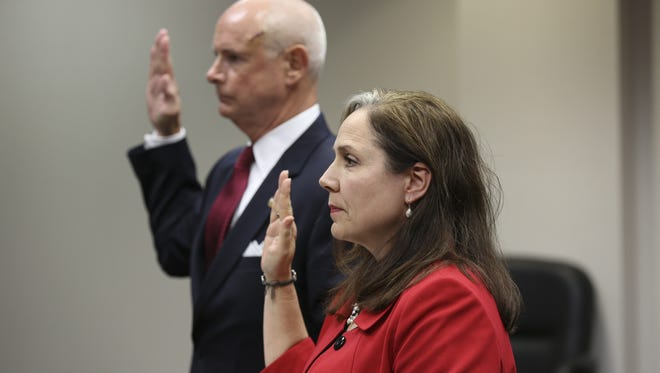 Maggie Cassaro, right, and Ken Herrington were sworn in Thursday during their trial to settle a dispute over damages Cassaro suffered to her vehicle after hitting and killing Herrington's dog.