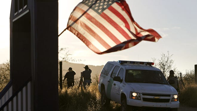 Border Patrol agents block a road leading to the search area in December 2010, after Brian Terry was shot and killed.