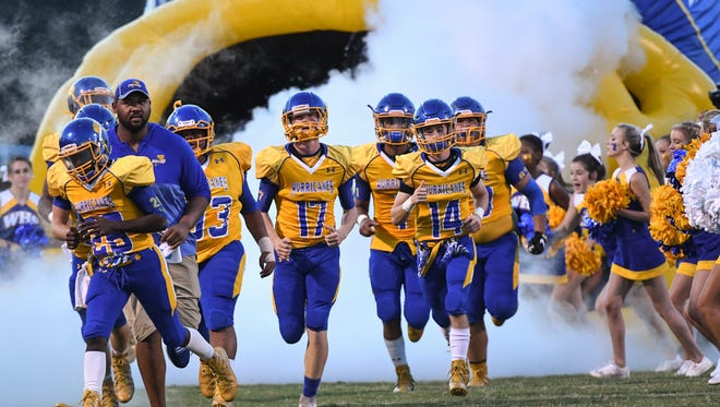 Wren High School players run on the field before kickoff between Palmetto and Wren in Piedmont on Friday.