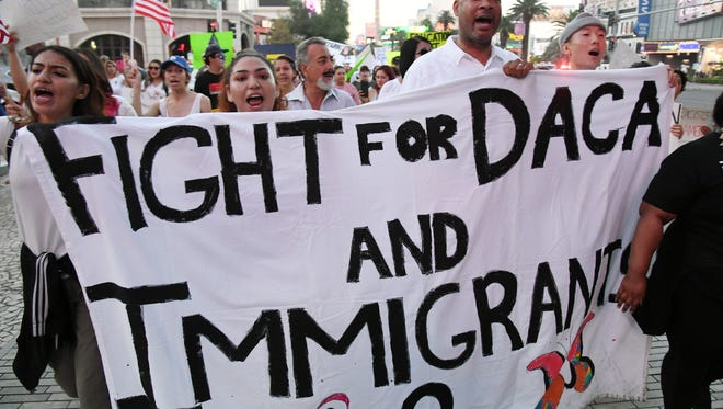 "Immigrants and supporters march in Las Vegas during a ""We Rise for the Dream"" rally to oppose U.S. President Donald Trump's order to end DACA."