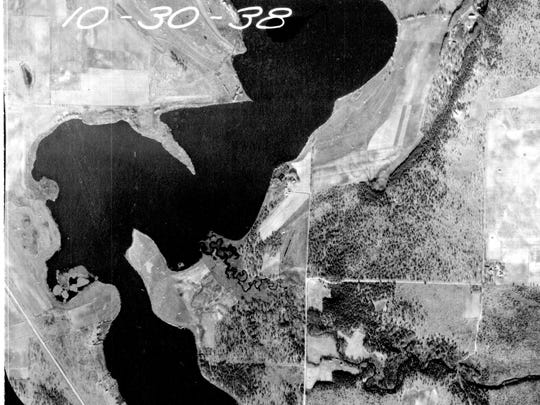 This aerial photo of Little Rock Lake taken in October of 1938 shows a rock pile or point on the west shoreline extending fairly far out into the lake. Google map photos now show much of that area is no longer visible.