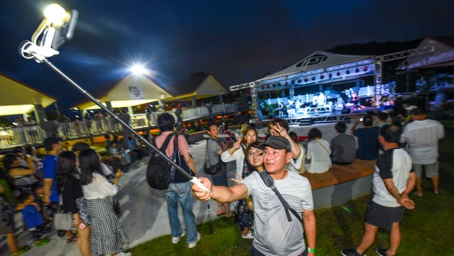 Island residents, visiting tourists and others gather for the opening of the 74th Guam Liberation Festival and the weekly night market at the Chamorro Village in Hagåtña on Wednesday, July 11, 2018.
