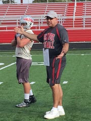 Bellevue High School football coach Ed Nasonti instructs his team in practice on Monday. Nasonti, in his 25th season as head coach, is one win shy of his 200th career victory.