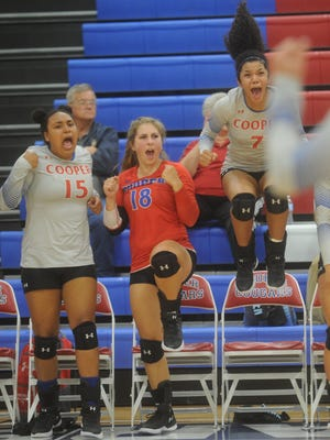 Cooper's Diamond Brown (7), Lexi Rau (18) and Jada Willis (15) celebrate a point late in the fifth game against Lubbock Monterey. The Lady Cougars went on to beat Monterey 25-18, 26-28, 25-21, 24-26, 16-14 in the District 4-5A volleyball match Tuesday, Sept. 26, 2017 at Cougar Gym. It was Cooper's seventh straight victory as the Lady Coogs improved to 20-10 overall and 2-0 in district.