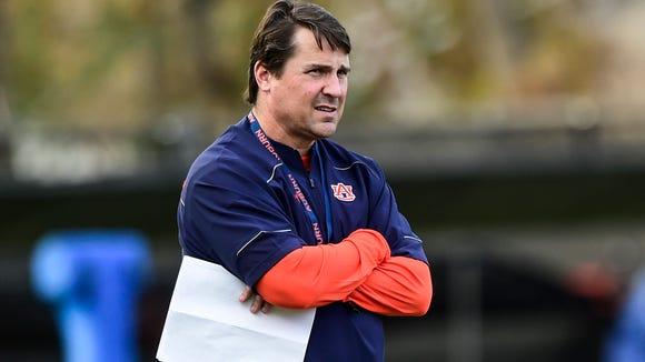 Auburn defensive coordinator Will Muschamp watches practice on Monday.