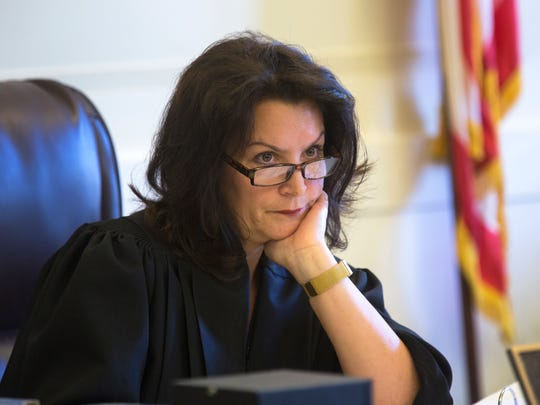 Hamilton County Common Pleas Judge Leslie Ghiz listens