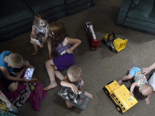 Tablets and toys keep John Lake Jr.'s grandkids entertained