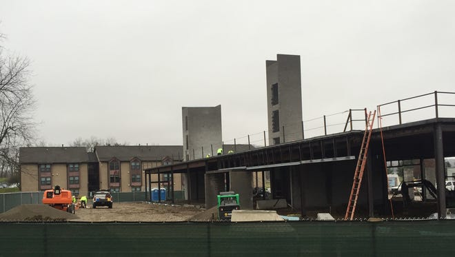 Dormitories under construction at the Newark campus of Ohio State University and Central Ohio Technical College.