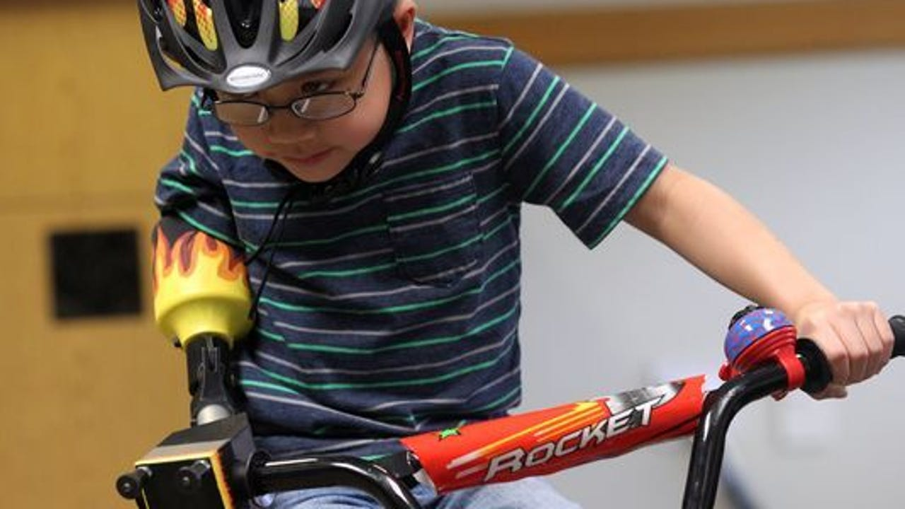 Engineering students help 8-year-old ride his bike